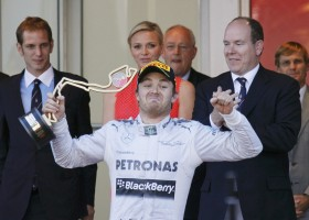 Mercedes Formula One driver Nico Rosberg of Germany celebrates as he holds the trophy after winning the Monaco F1 Grand Prix