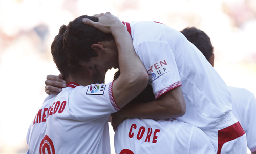 Alegría tras uno de los goles del Sevilla.