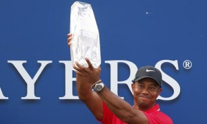 Woods lifts The Players Championship trophy in the air after winning the PGA golf tournament in Ponte Vedra Beach