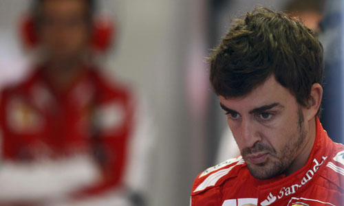 Ferrari Formula One driver Alonso of Spain reacts in garage during third practice session of Canadian F1 Grand Prix at the Circuit Gilles Villeneuve in Montreal