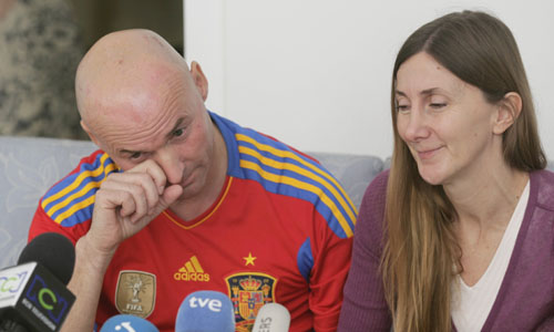 Spanish citizens Fernandez and Marlaska cry as they speak to the media during a news conference in Bogota