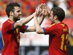 Spain's Fabregas celebrates a first half goal against Haiti with teammate Mata during an exhibition soccer match in Miami Gardens