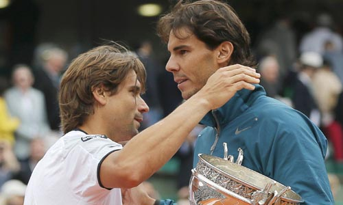 Nadal of Spain embraces compatriot Ferrer after winning their men's singles final match at the French Open tennis tournament in Paris