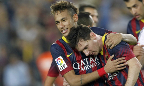 "Barcelona's Neymar and Messi celebrate victory over Real Madrid at the end of their Spanish first division ""Clasico"" soccer match in Barcelona"