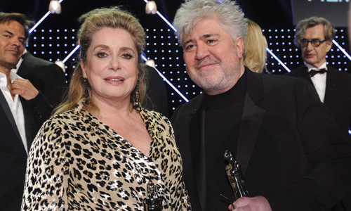 French actress Deneuve and Spanish director Almodovar pose with their trophies after the European Film Awards ceremony in Berlin