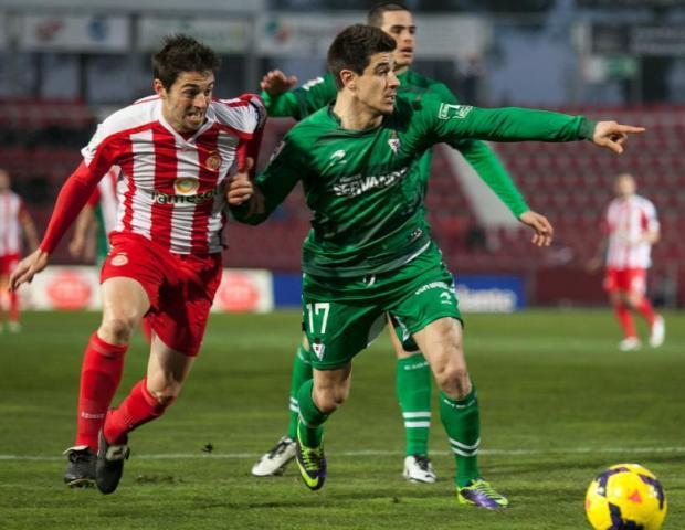 Yuri (derecha), vestido ya de verde en el Girona-Eibar de esta campaña / LFP
